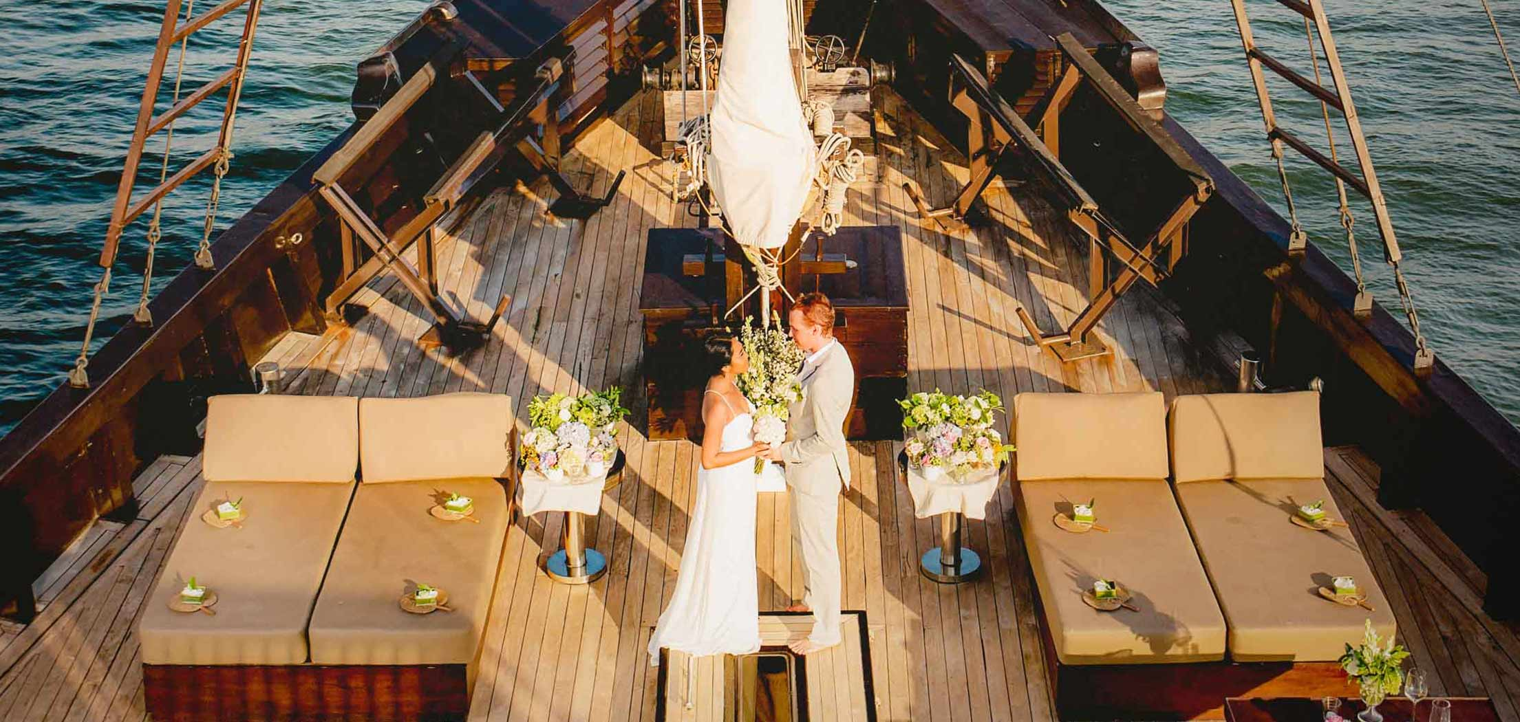 A groom and a bride getting married on board of Dunia Baru luxury superyacht
