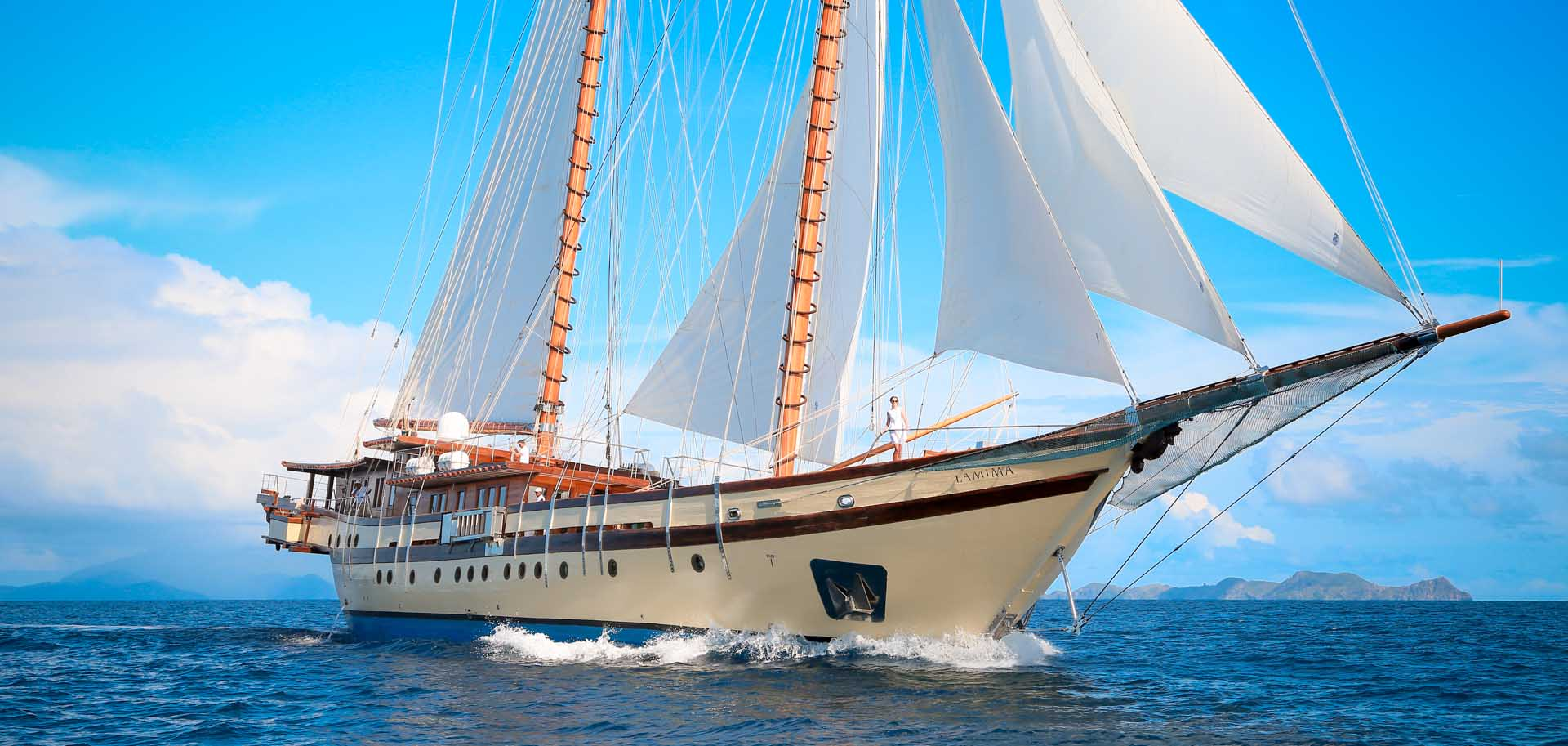 Lamima superyacht for charter with her sails up, cruising through the the blue waters of Indonesia